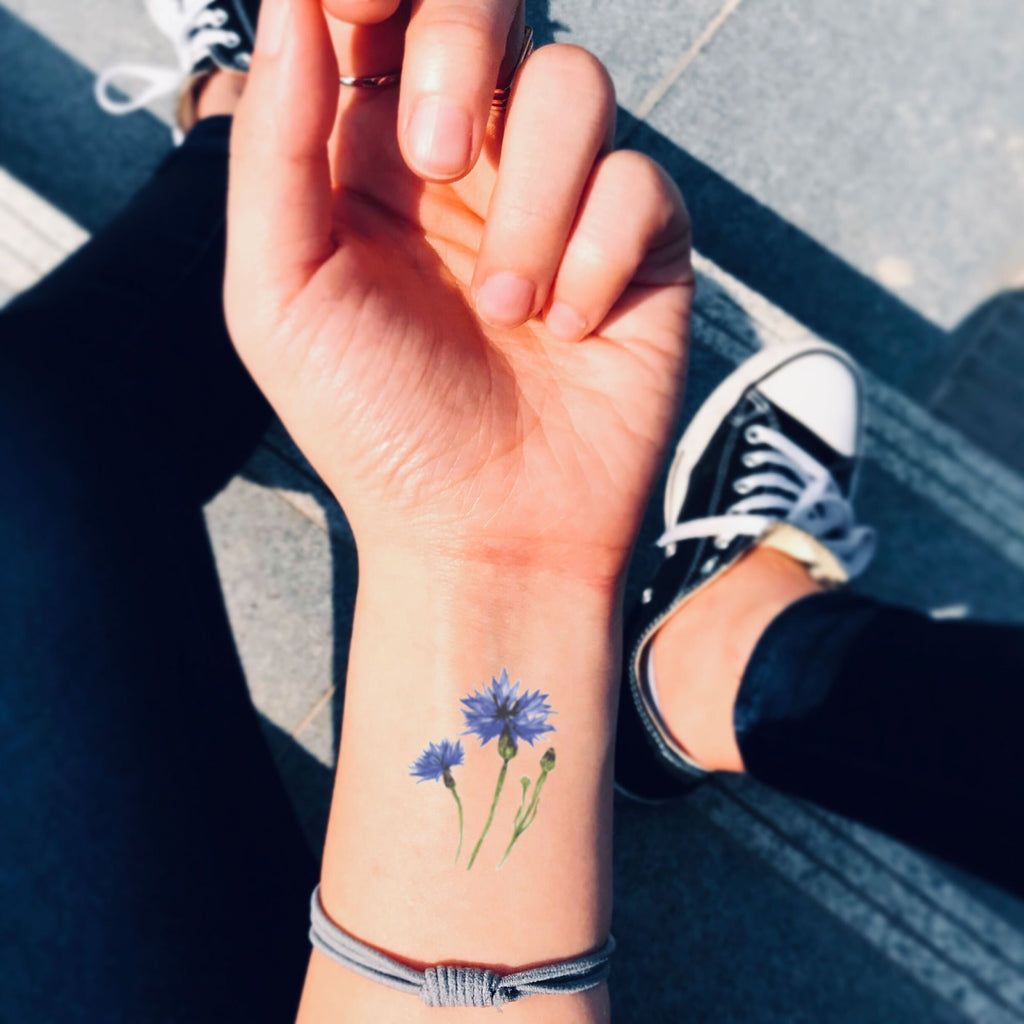fake small cornflower Flower temporary tattoo sticker design idea on wrist