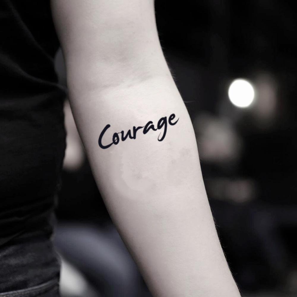 fake small courage lettering temporary tattoo sticker design idea on inner arm