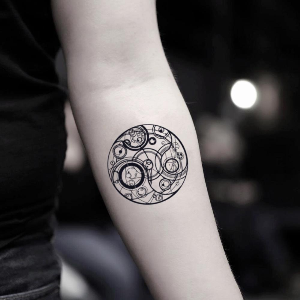 fake small gallifreyan doctor who geometric temporary tattoo sticker design idea on inner arm