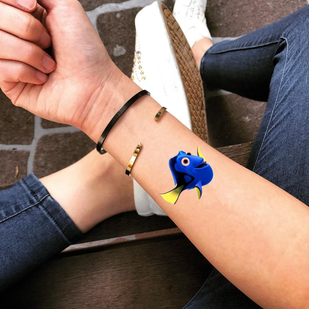 fake small dory cartoon color temporary tattoo sticker design idea on wrist