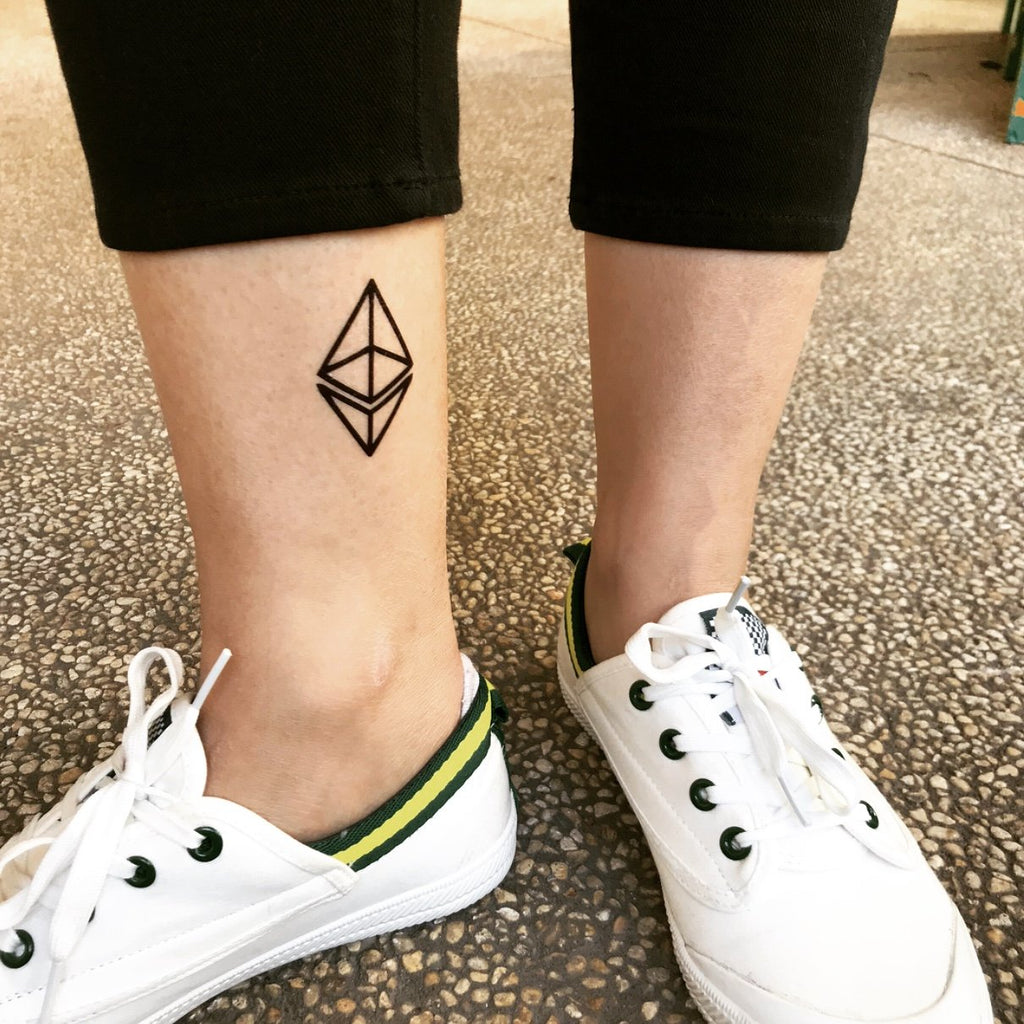 fake small ethereum geometric temporary tattoo sticker design idea on ankle