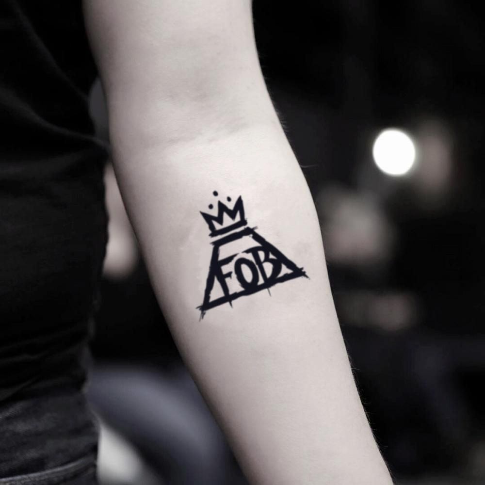 fake small fall out boy fob logo illustrative temporary tattoo sticker design idea on inner arm