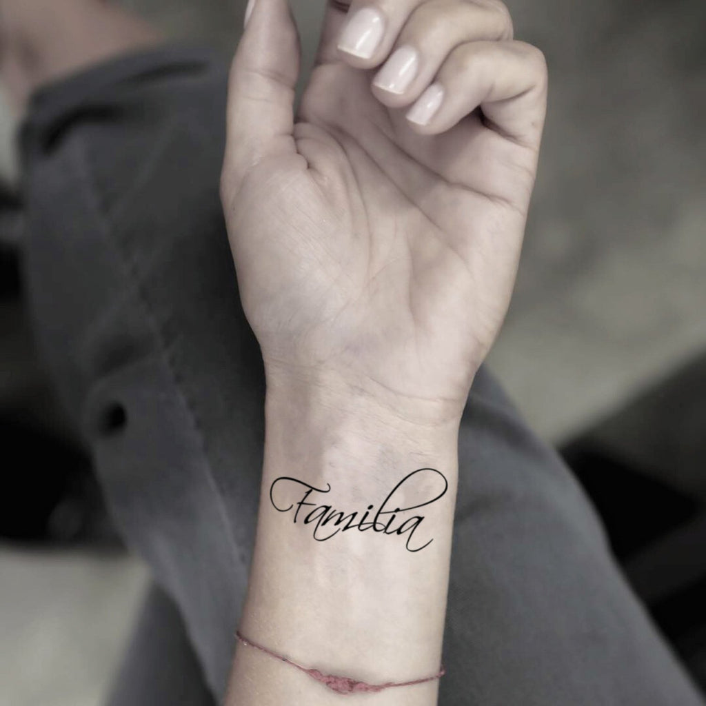 fake small familia lettering temporary tattoo sticker design idea on wrist