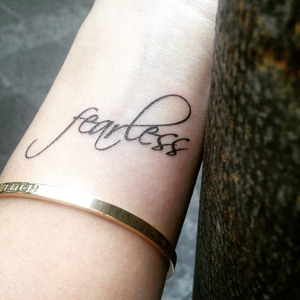 fake small fearless encouraging lettering temporary tattoo sticker design idea on wrist