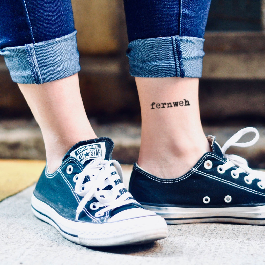 fake small fernweh lettering temporary tattoo sticker design idea on ankle