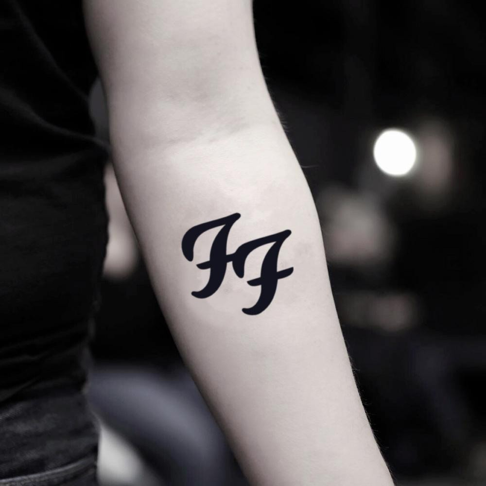 fake small foo fighters lettering temporary tattoo sticker design idea on inner arm