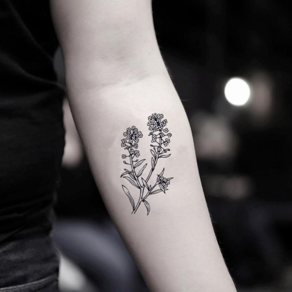 fake small forget me not flower temporary tattoo sticker design idea on inner arm