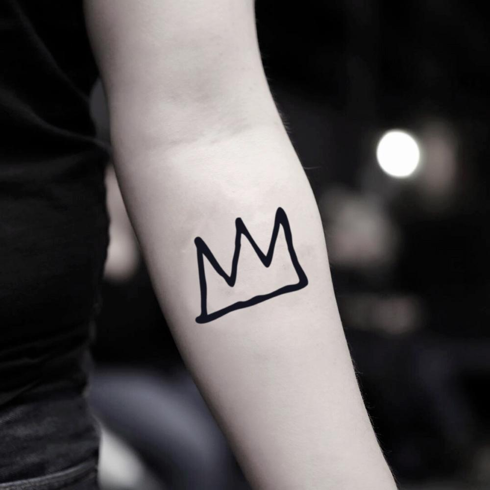 fake small g dragon basquiat crown minimalist temporary tattoo sticker design idea on inner arm
