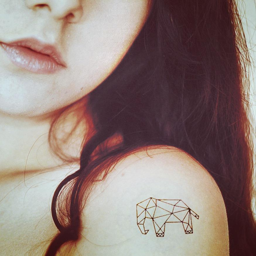 fake small geometric elephant animal temporary tattoo sticker design idea on shoulder