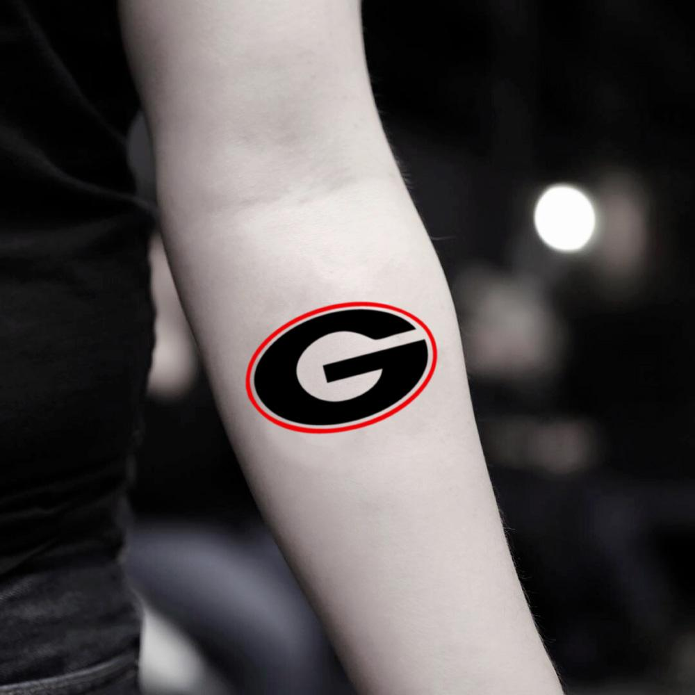 fake small uga georgia bulldog lettering temporary tattoo sticker design idea on inner arm