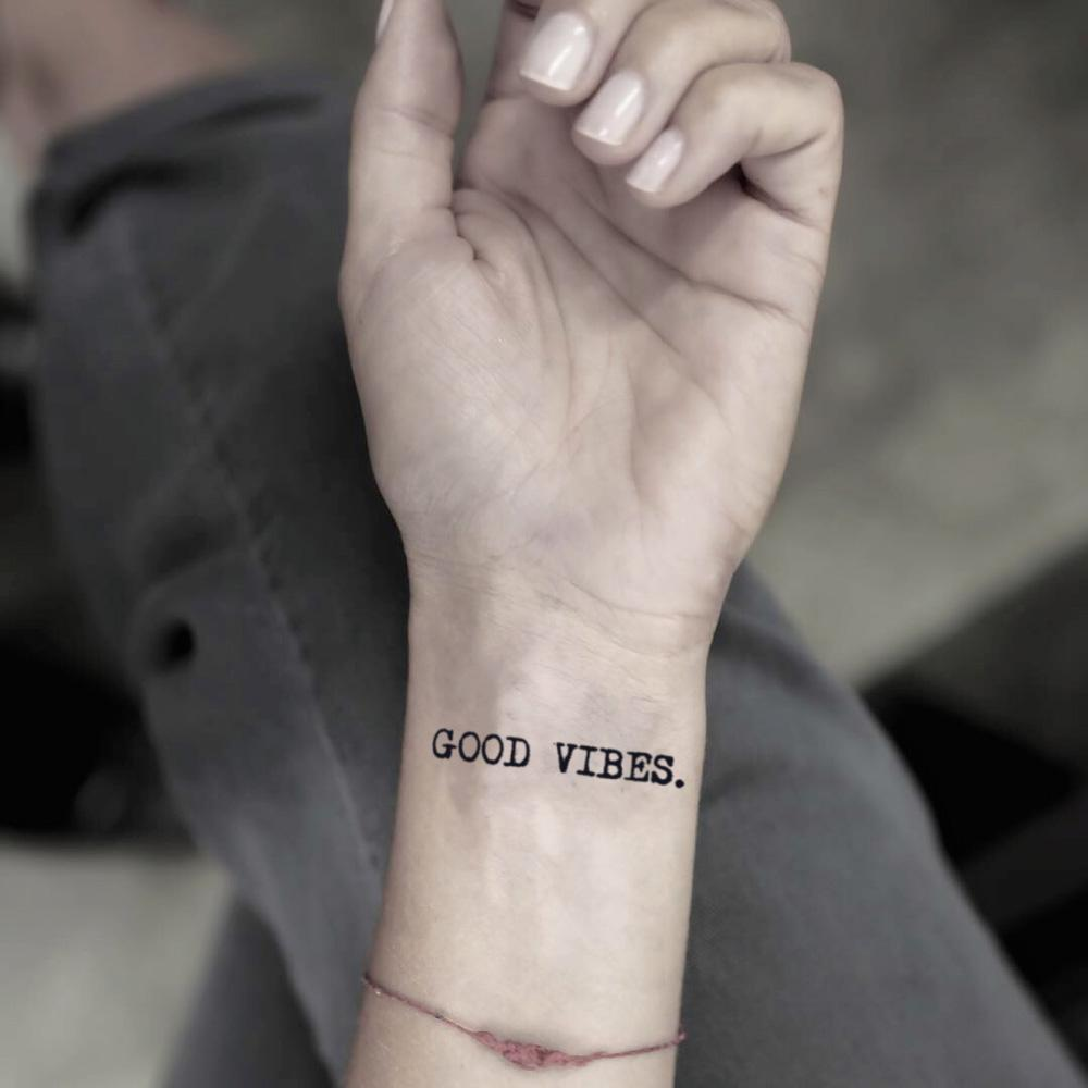 fake small good vibes quote lettering temporary tattoo sticker design idea on wrist