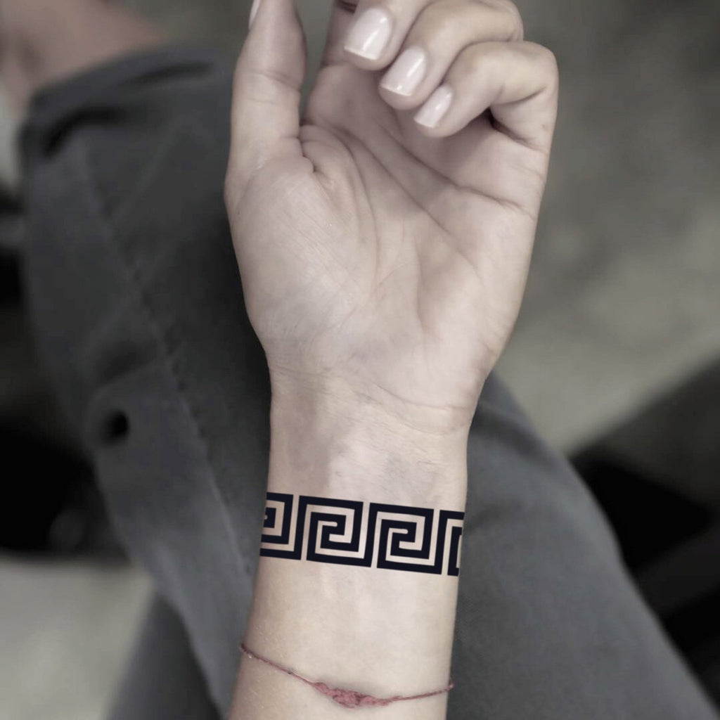 fake small greek key geometric temporary tattoo sticker design idea on wrist