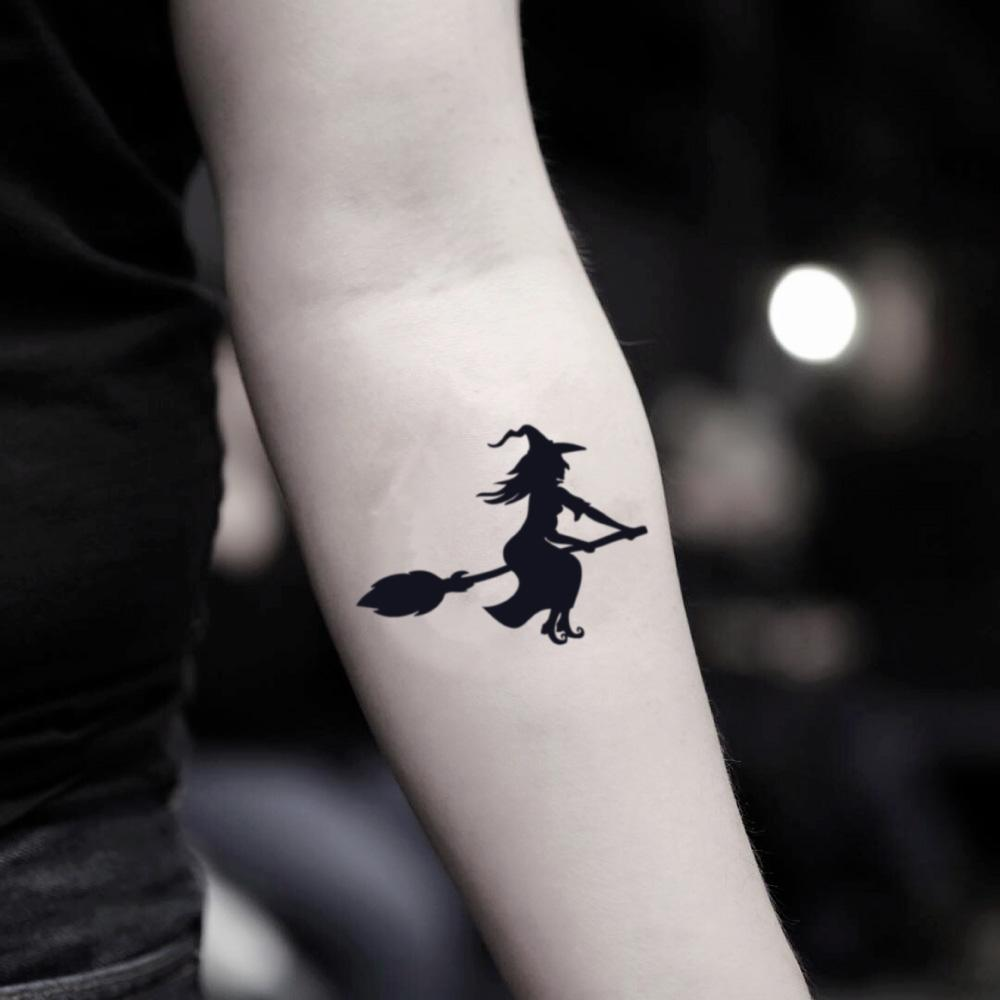 fake small halloween witch minimalist temporary tattoo sticker design idea on inner arm