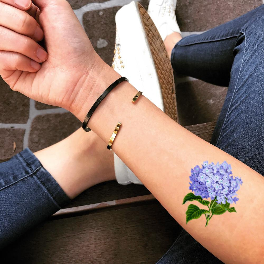 fake small hydrangea blue flower color temporary tattoo sticker design idea on forearm