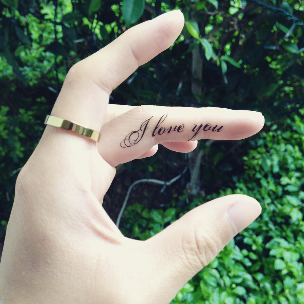 fake small i love you lettering temporary tattoo sticker design idea on finger