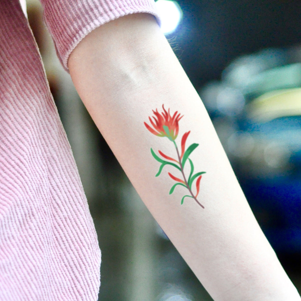 fake small indian paintbrush flower temporary tattoo sticker design idea on inner arm