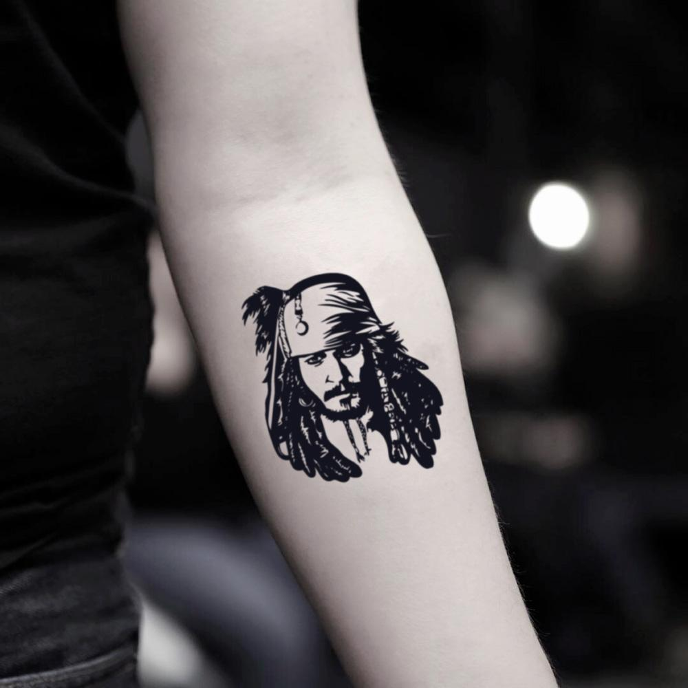 fake small jack sparrow pirate face portrait temporary tattoo sticker design idea on inner arm
