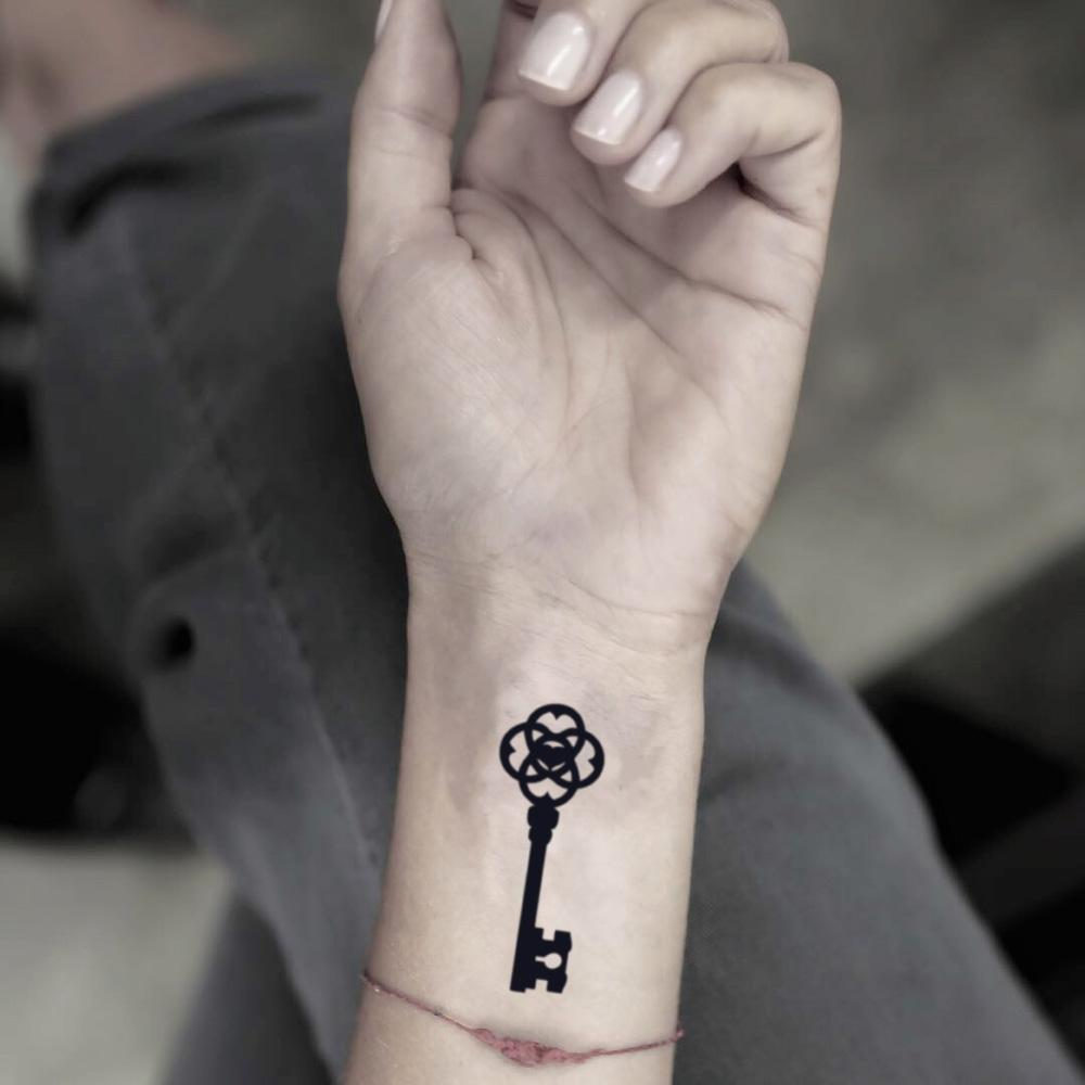 fake small skeleton key keyblade illustrative temporary tattoo sticker design idea on wrist