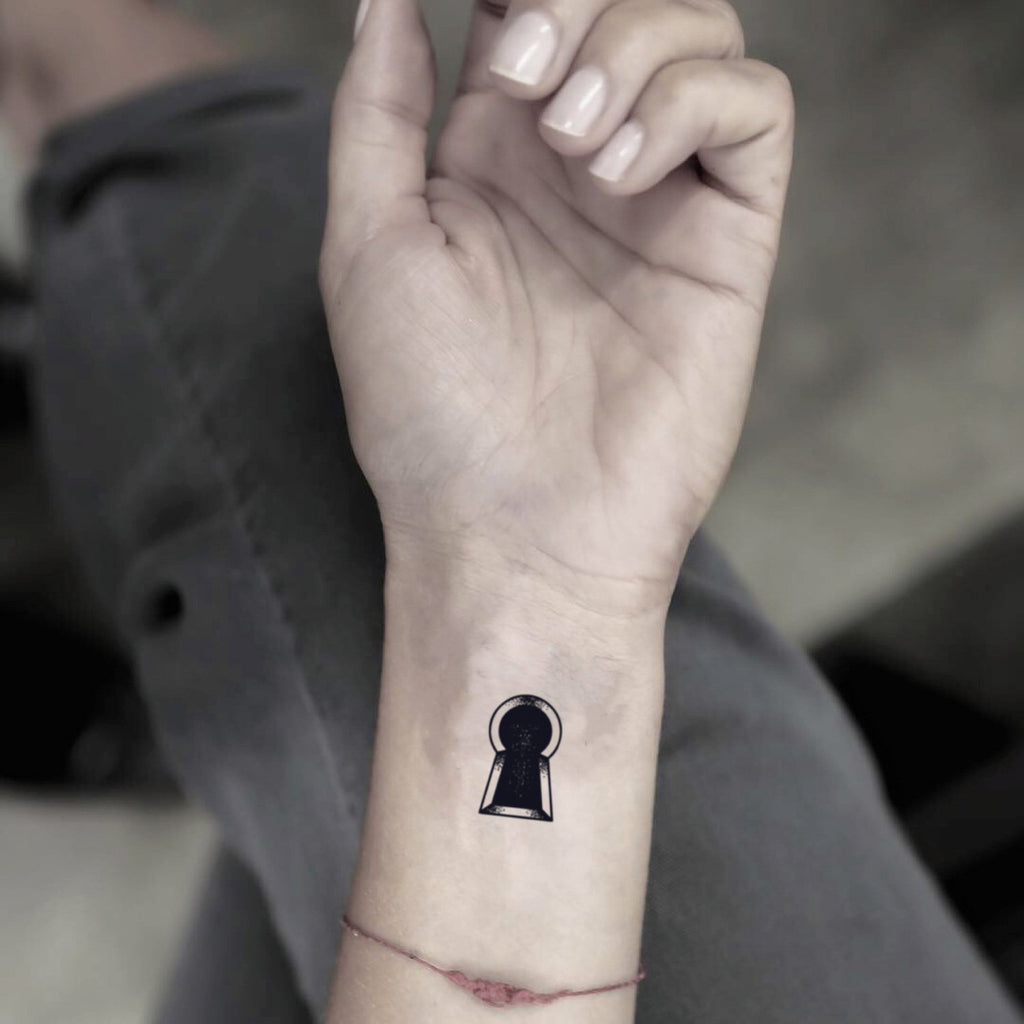 fake small keyhole minimalist temporary tattoo sticker design idea on wrist