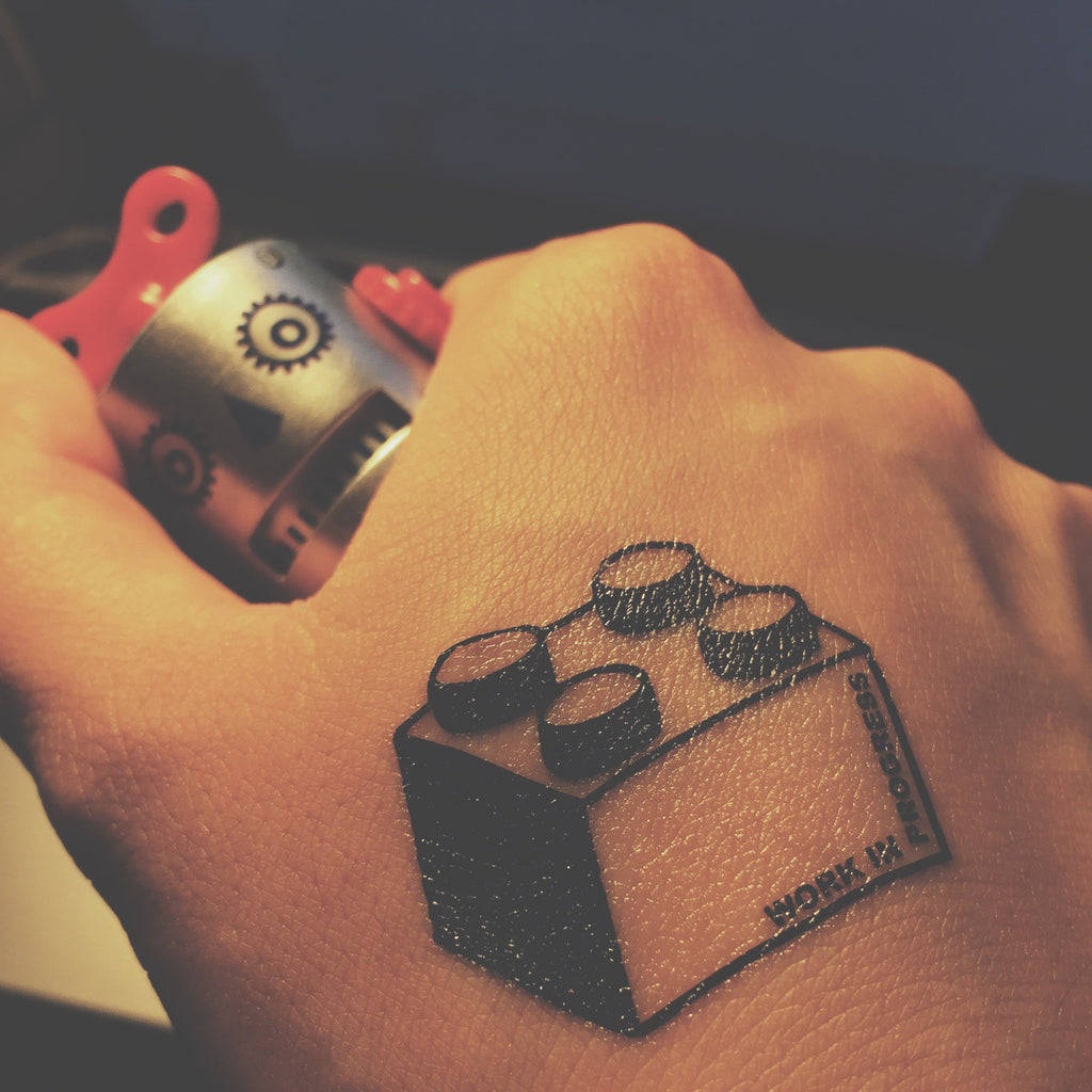 fake small lego block illustrative temporary tattoo sticker design idea on wrist