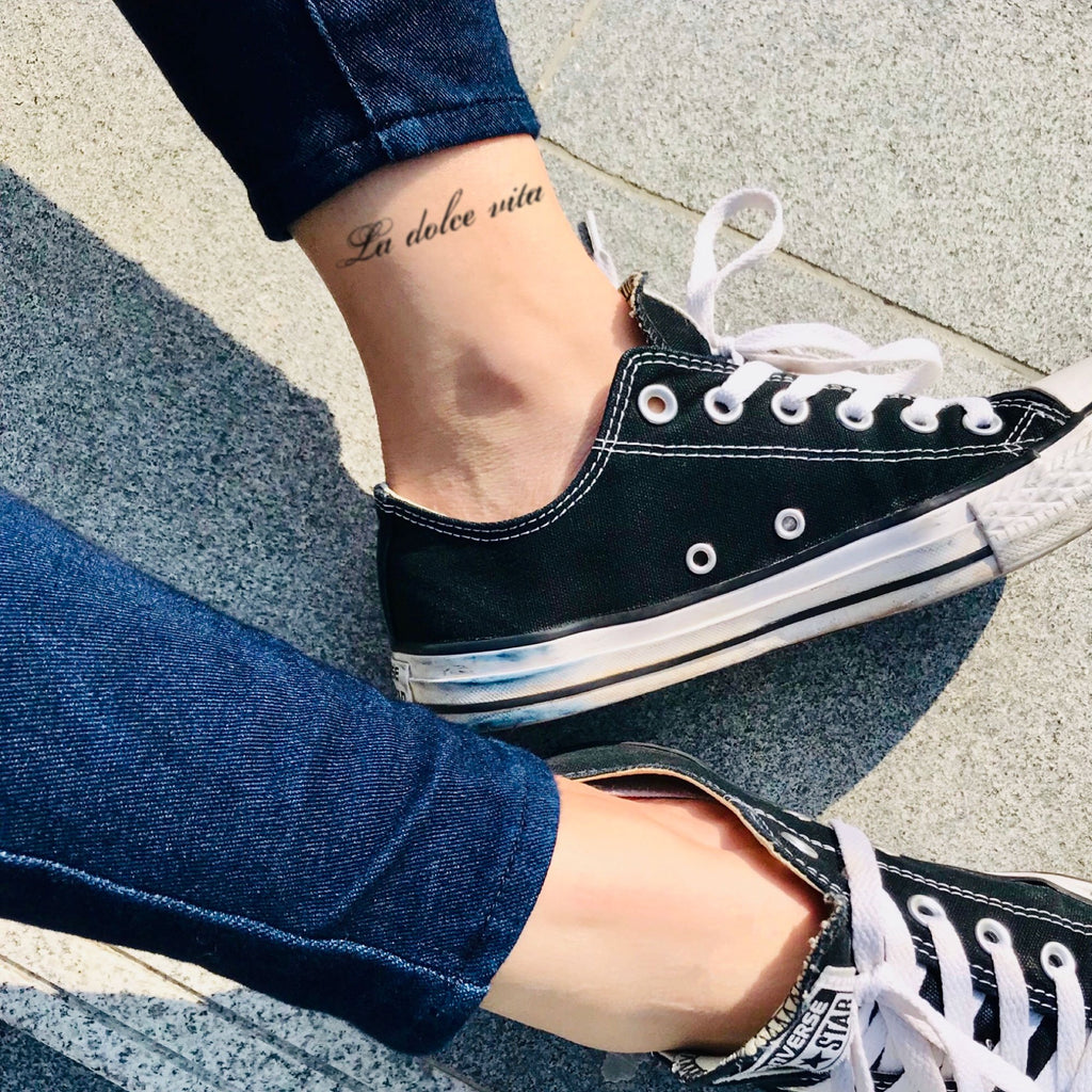 fake small la dolce vita Lettering temporary tattoo sticker design idea on ankle