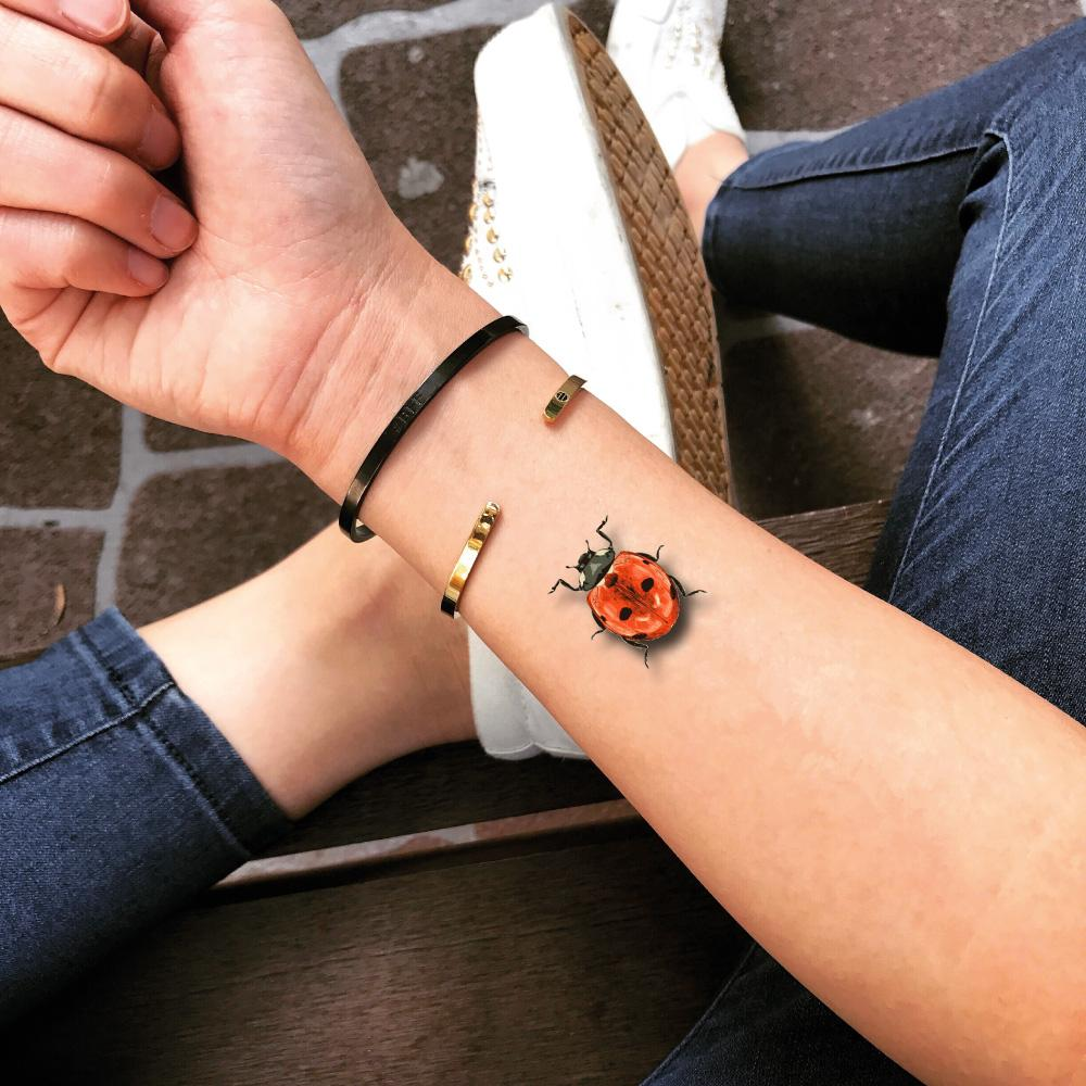 fake small ladybug love bug animal color temporary tattoo sticker design idea on wrist