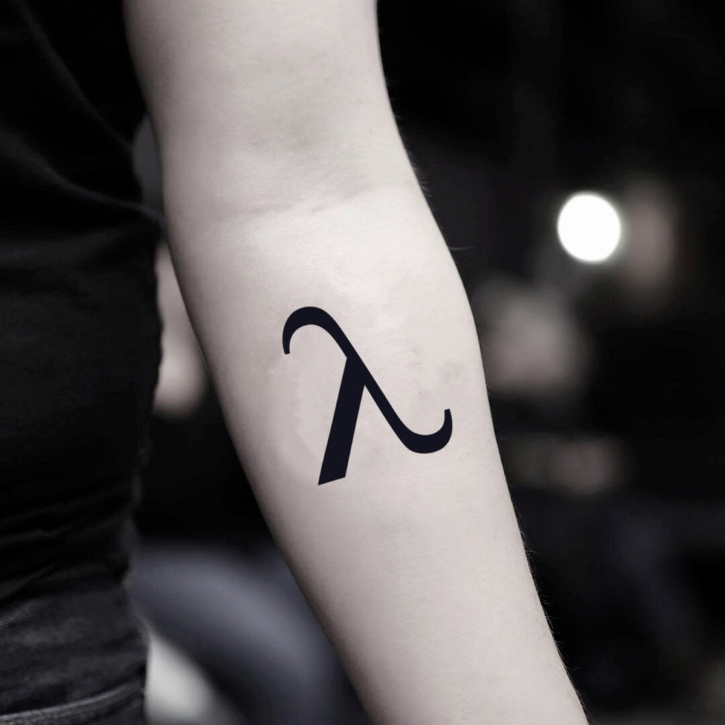 fake small lambda minimalist temporary tattoo sticker design idea on inner arm