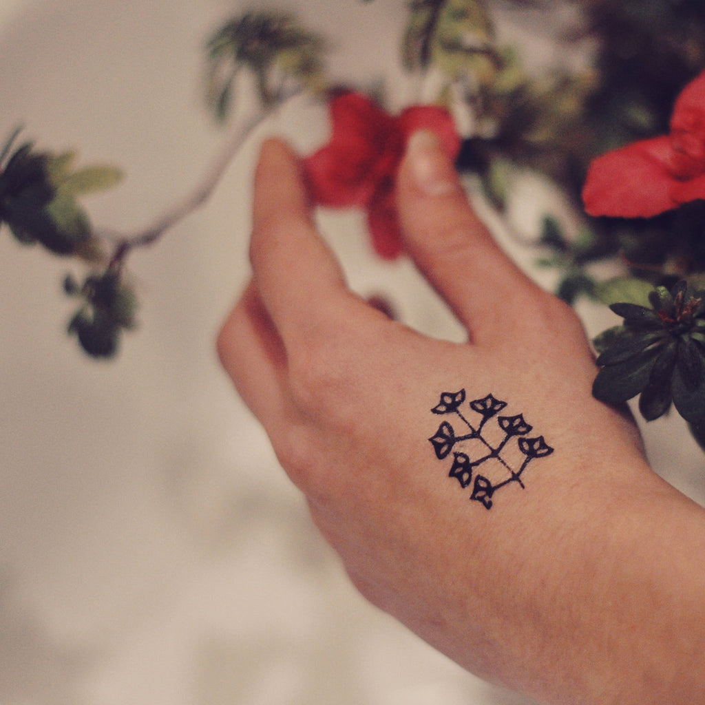 fake small little plant nature temporary tattoo sticker design idea on wrist