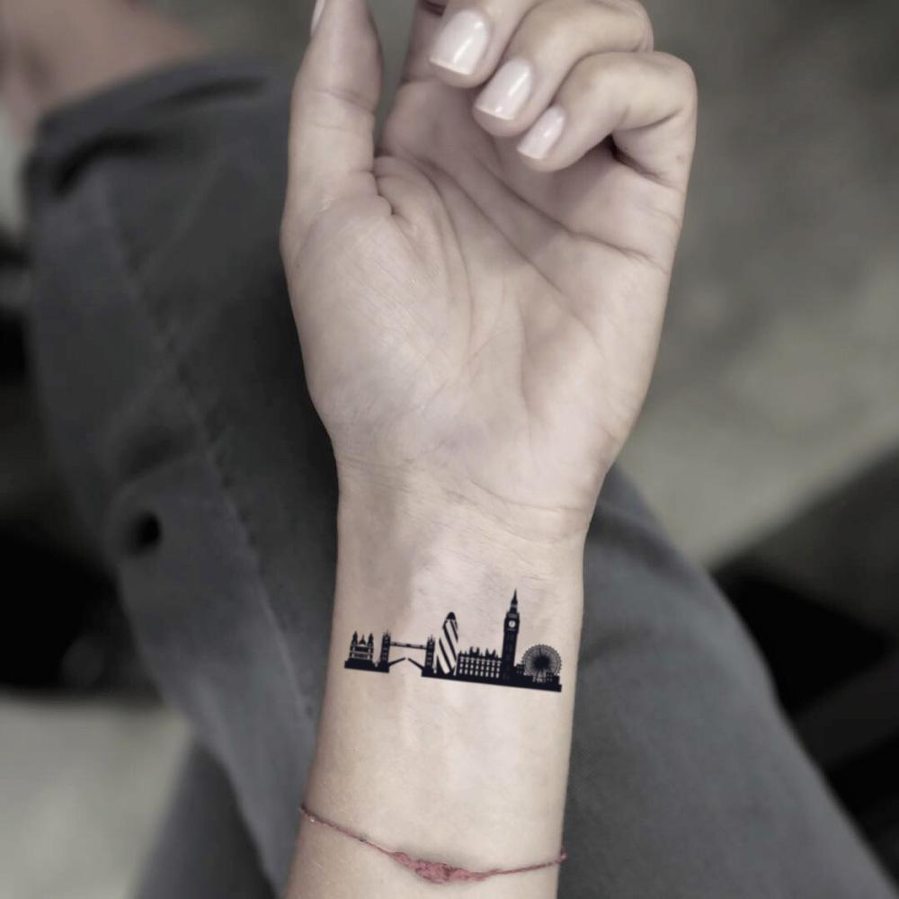 fake small london skyline illustrative temporary tattoo sticker design idea on wrist