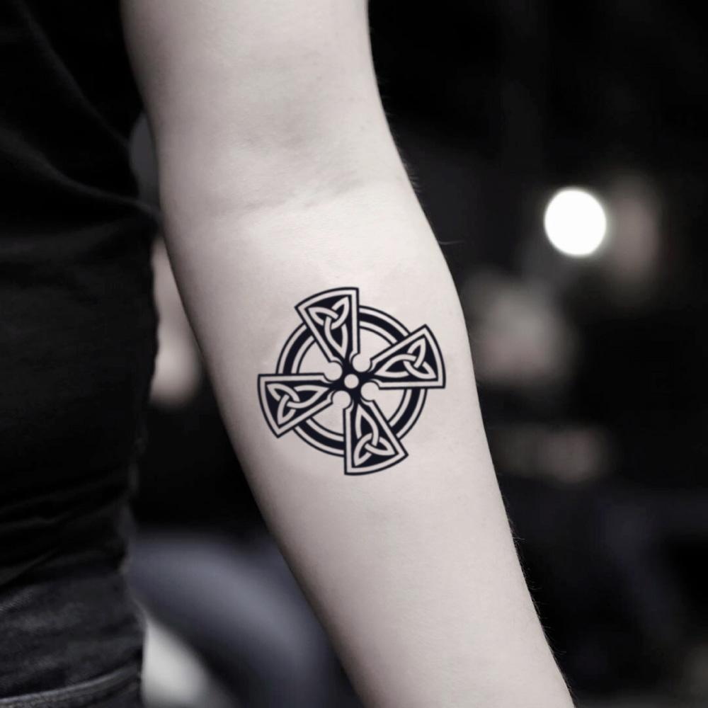 fake small maltese cross geometric temporary tattoo sticker design idea on inner arm