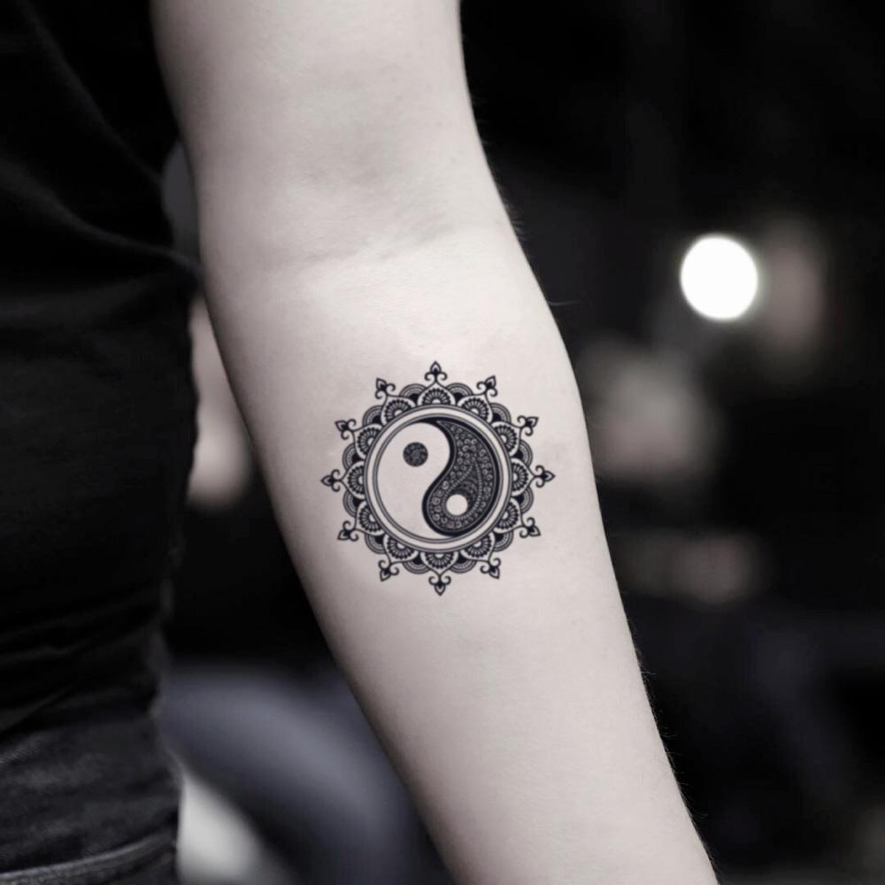 fake small mandala yin yang symbol bohemian temporary tattoo sticker design idea on inner arm