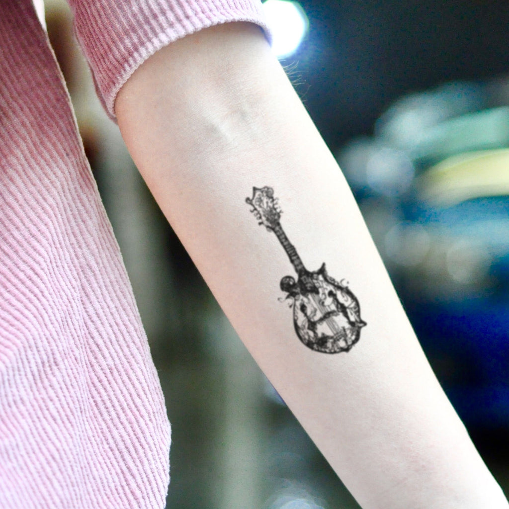 fake small mandolin music temporary tattoo sticker design idea on inner arm