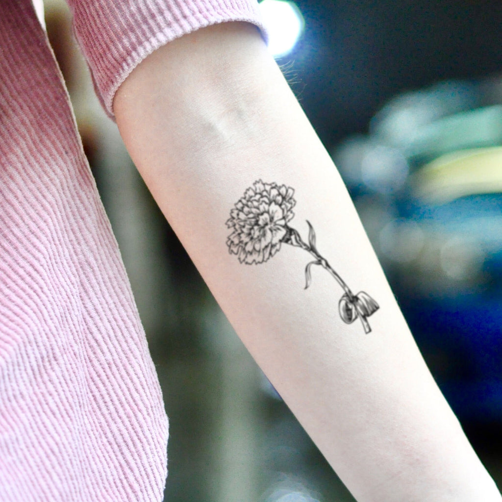 fake small marigold flower temporary tattoo sticker design idea on inner arm