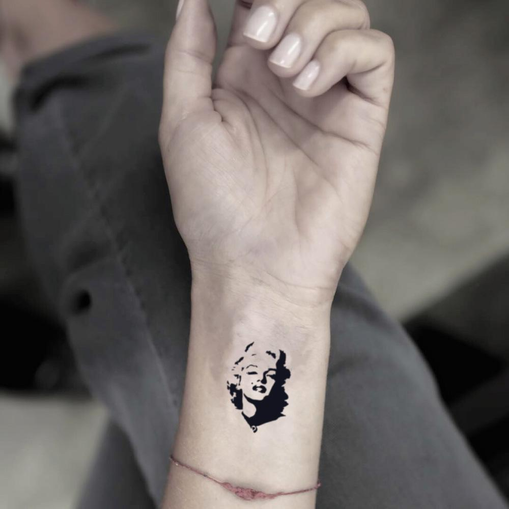 fake small marilyn monroe madonna portrait temporary tattoo sticker design idea on wrist