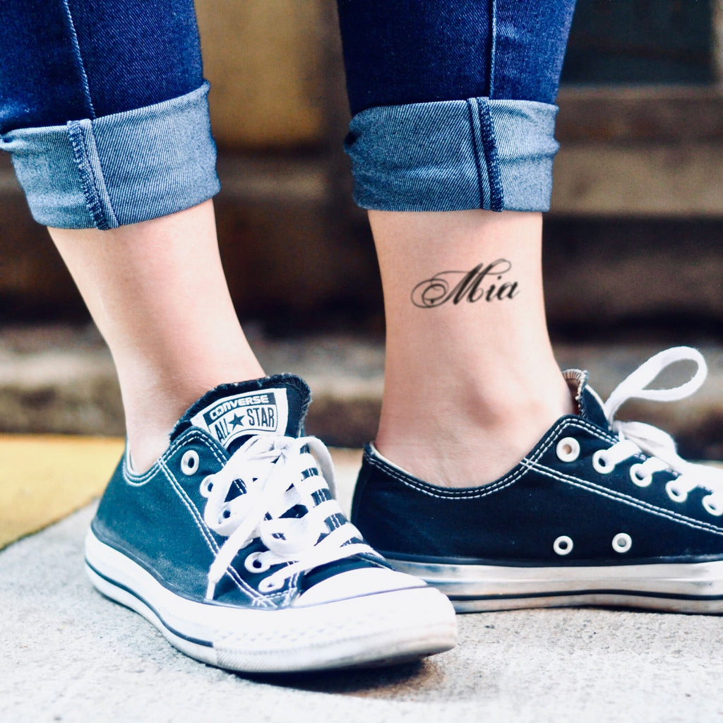 fake small mia name lettering temporary tattoo sticker design idea on ankle