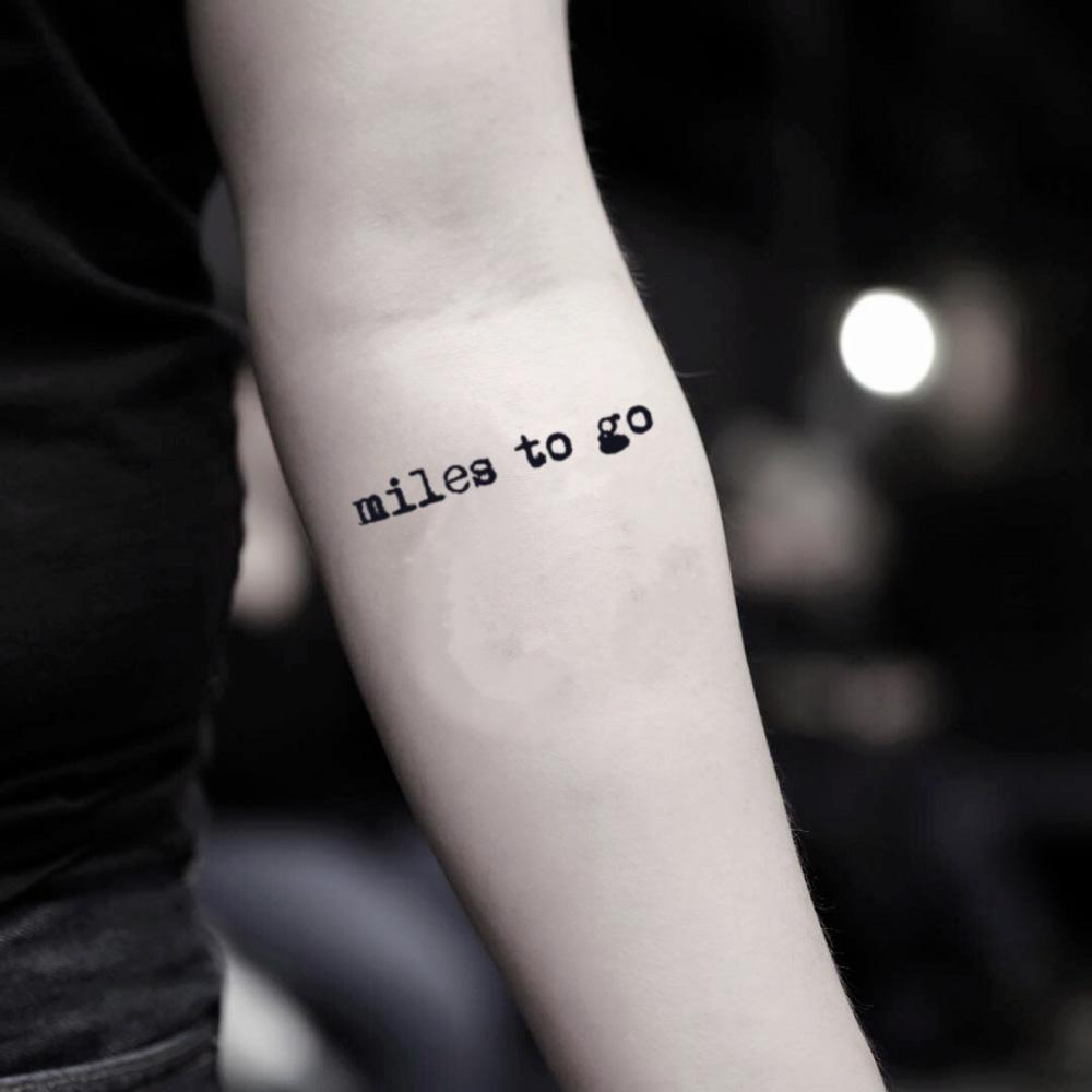 fake small miles to go quote lettering temporary tattoo sticker design idea on inner arm