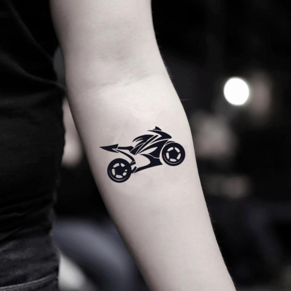 fake small motorcycle moto motocross chopper dirt sports bike rider illustrative temporary tattoo sticker design idea on inner arm