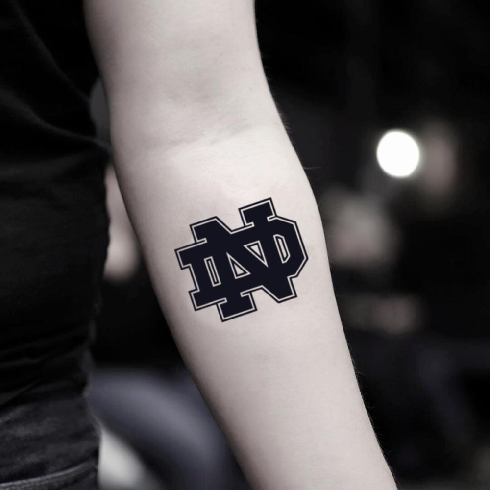 fake small notre dame lettering temporary tattoo sticker design idea on inner arm