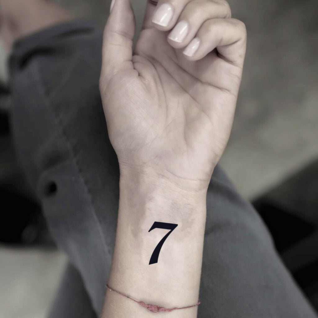fake small number 7 numeral lettering temporary tattoo sticker design idea on wrist