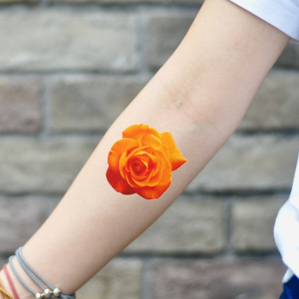 fake small orange rose realistic flower temporary tattoo sticker design idea on inner arm