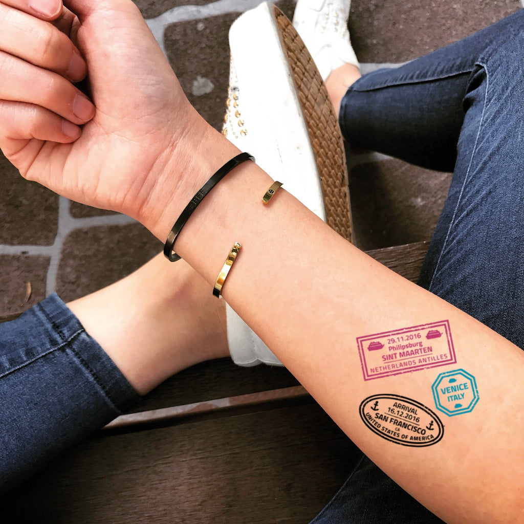 fake small passport stamp color temporary tattoo sticker design idea on forearm