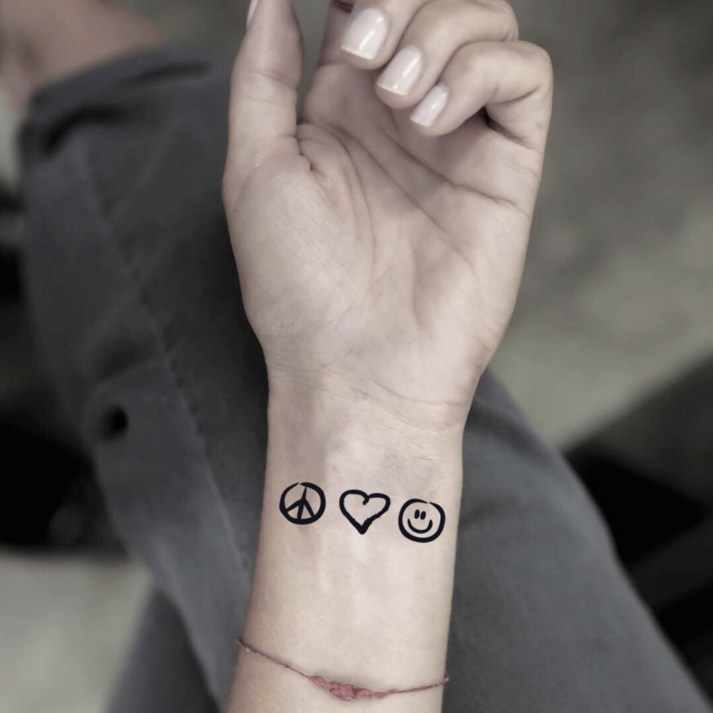 fake small peace love and happiness plur minimalist temporary tattoo sticker design idea on wrist