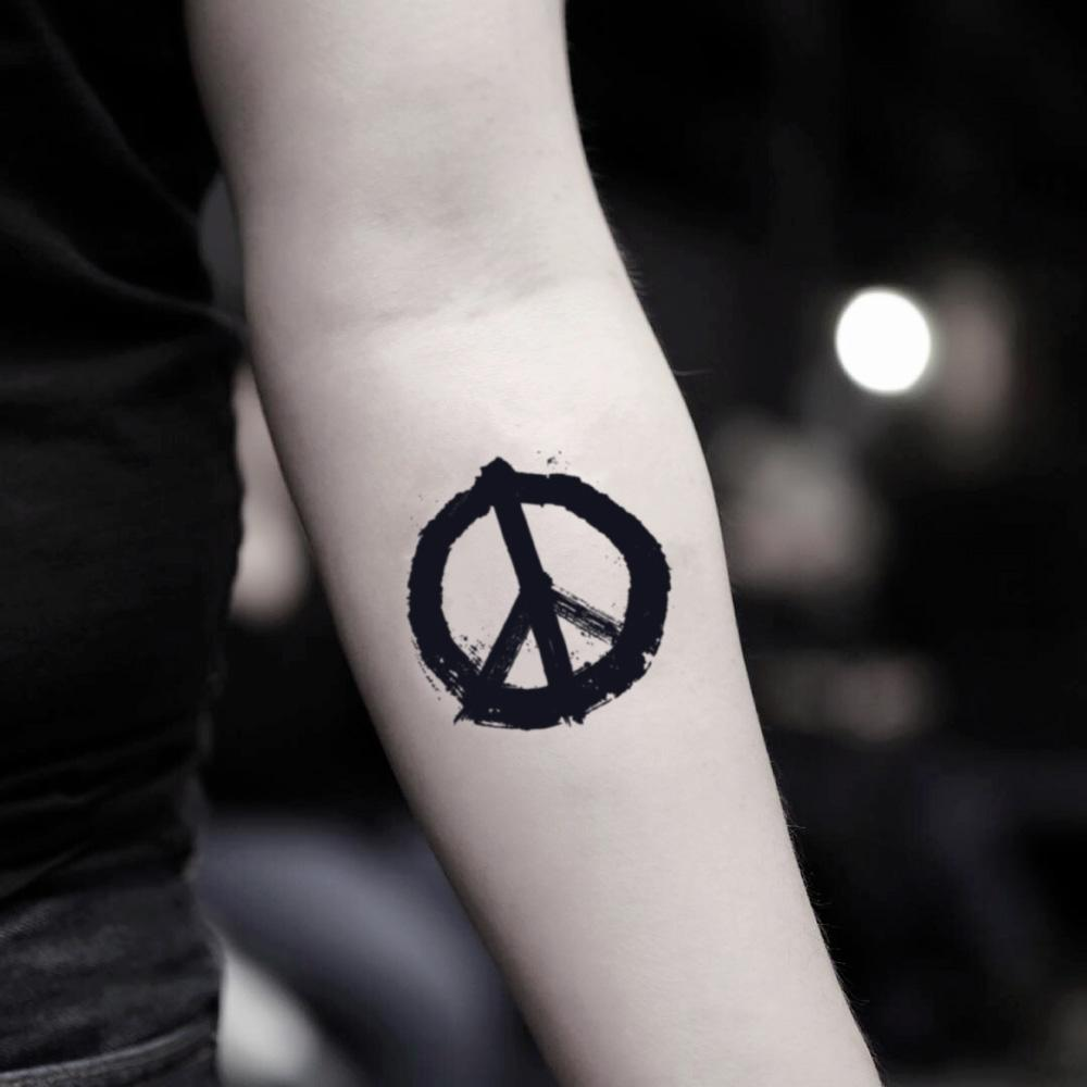 fake small peace symbol sign minimalist temporary tattoo sticker design idea on inner arm