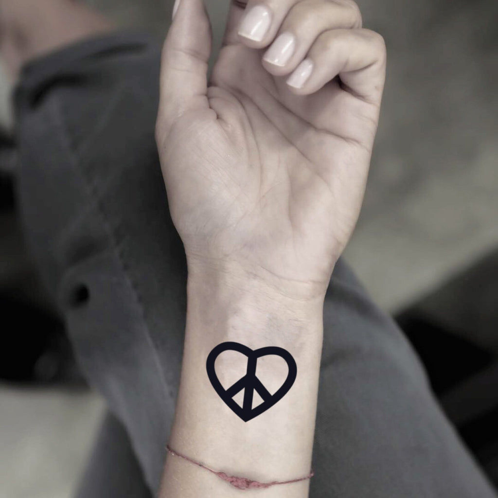 fake small peace and love minimalist temporary tattoo sticker design idea on wrist