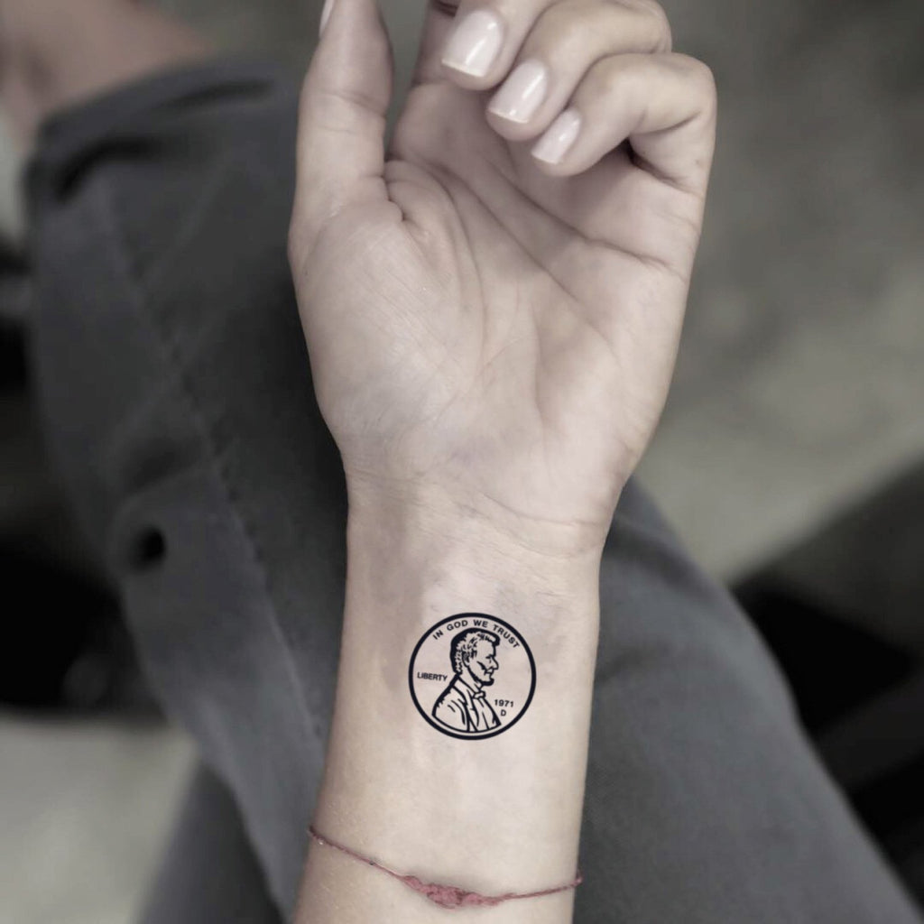 fake small penny dime silver dollar illustrative temporary tattoo sticker design idea on wrist