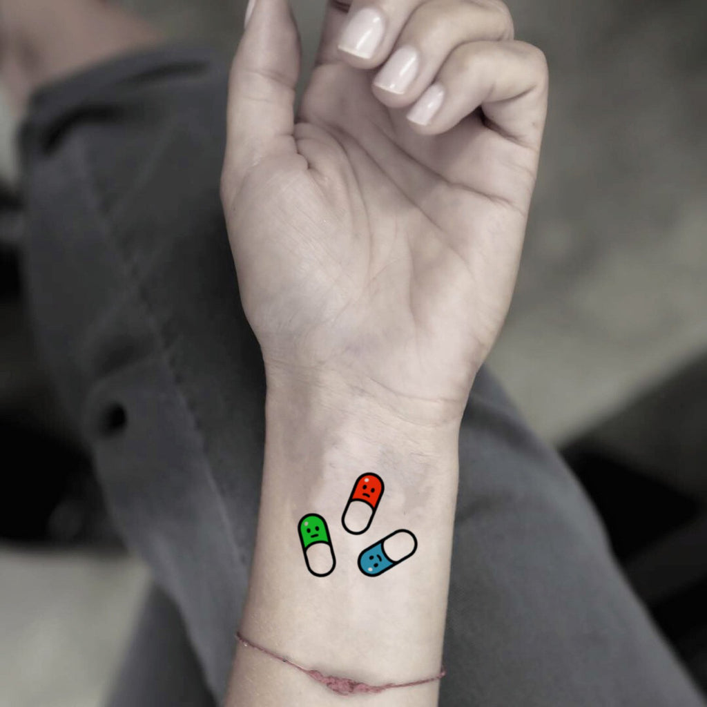 fake small pill color temporary tattoo sticker design idea on wrist