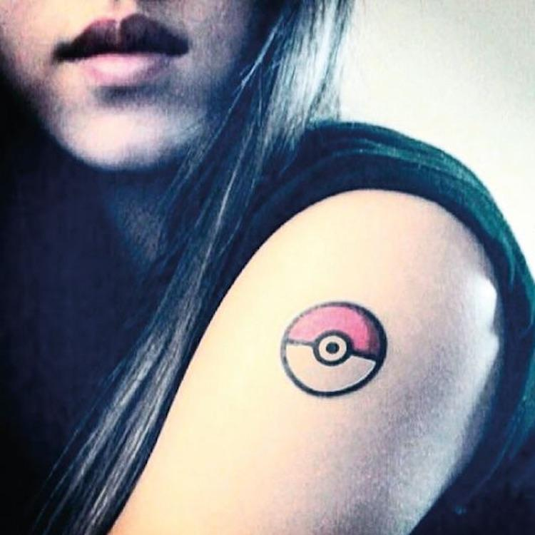 fake small pokemon pokeball cartoon color temporary tattoo sticker design idea on upper arm