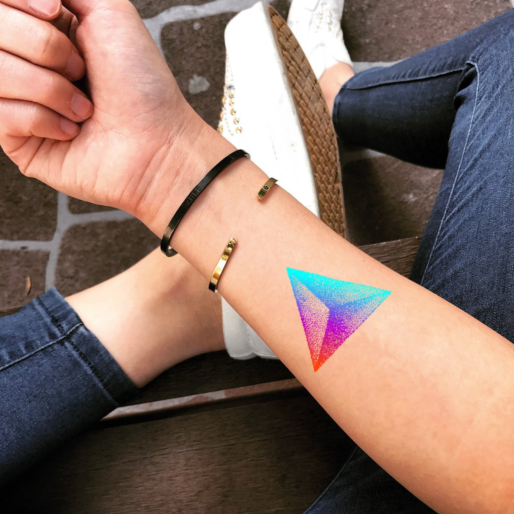 fake small prism rainbow pointillism color temporary tattoo sticker design idea on wrist