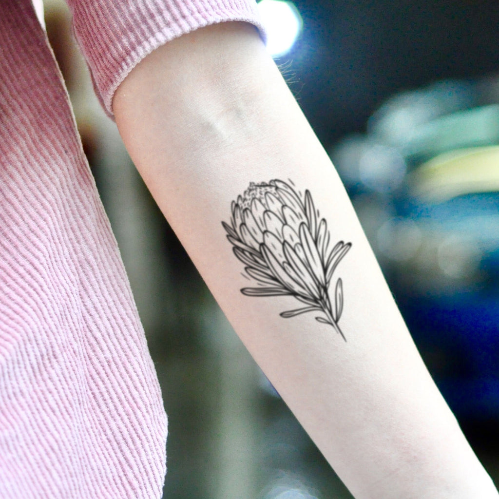fake small protea flower temporary tattoo sticker design idea on inner arm