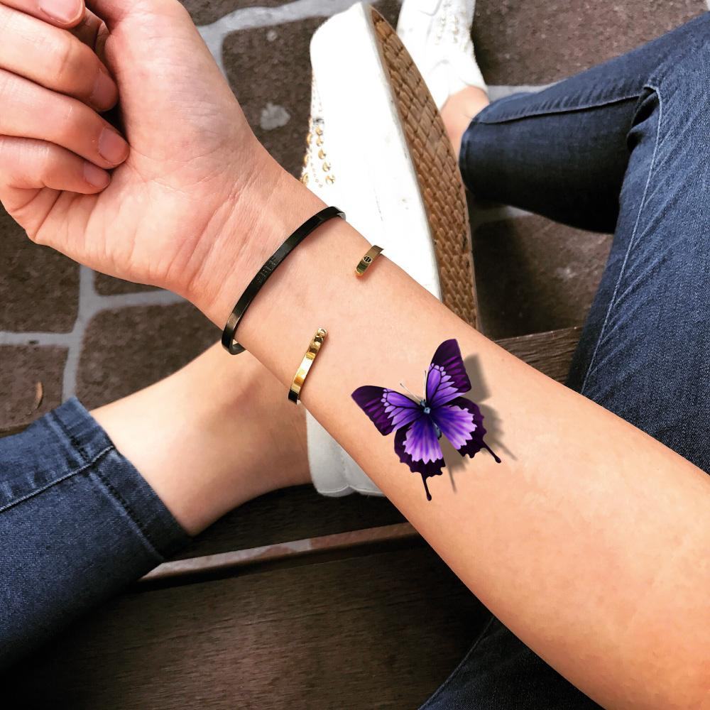 fake small purple butterfly color animal temporary tattoo sticker design idea on wrist